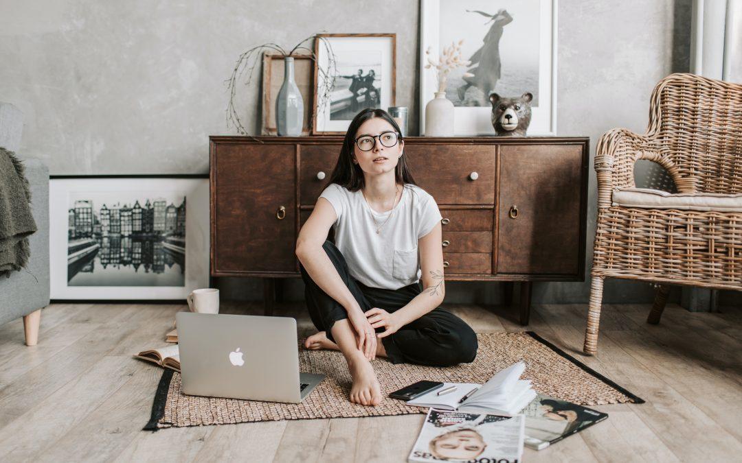 Woman sitting on floor thinking